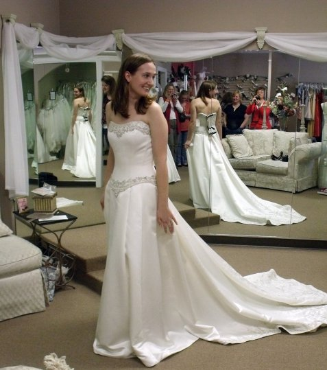 In the bridal salon, right after I decided that this was the dress. I love my cheering gallery that you can see in the mirror.
