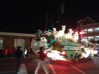 Santa and Mrs. Claus showing off their new ride, a fire truck!