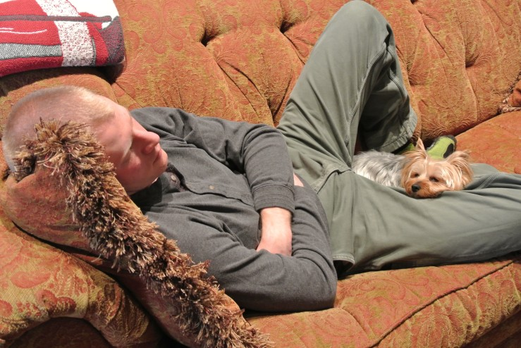 Taking a nap with his favorite dog at his parent's house over Christmas